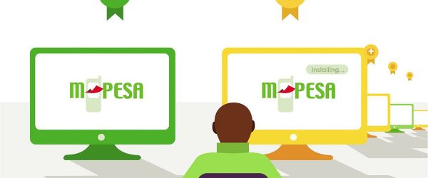 person facing one green screen and multiple golden screens showing mpesa logo